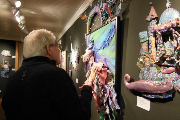 "Visitors explore Layl McDill's 2015 exhibition ""Windows into Wonderment."""