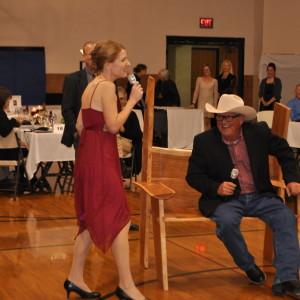 KTTC News' Jess Abrahamson jokes with auctioneer Mert Boyum during the Live Auction.