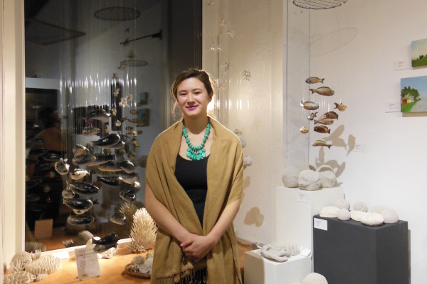 One of Lanesboro Arts' 2015 Emerging Artists, Ellie Schmidt, with her ceramic work.