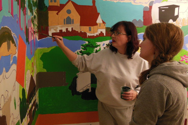 Leisa works on her commissioned community mural at the Lanesboro Public Library.